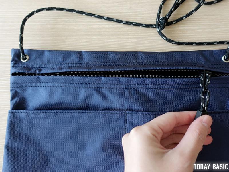 MEIのサコッシュバッグのファスナー付きポケット